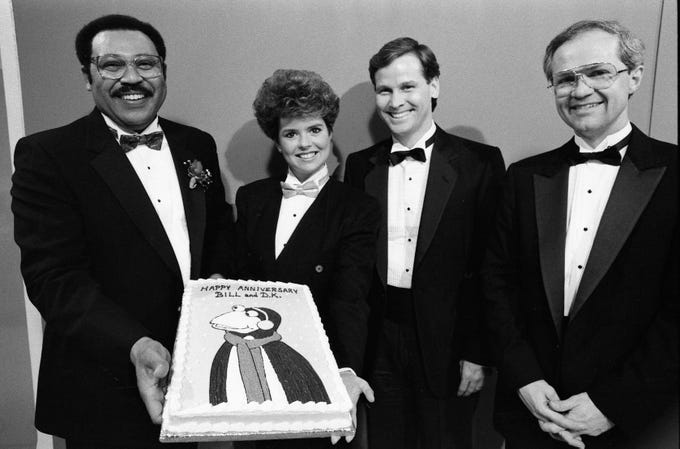 "It was a festive evening for the news team of WSMV-Channel 4's ""Scene at Six"" on Feb. 1, 1989. Celebrating weatherman Bill Hall's 15th anniversary at the station and anchor Demetria Kalodimos' fifth are Hall, left, Kalodimos, co-anchor Jeff McAtee and sportscaster Rudy Kalis."