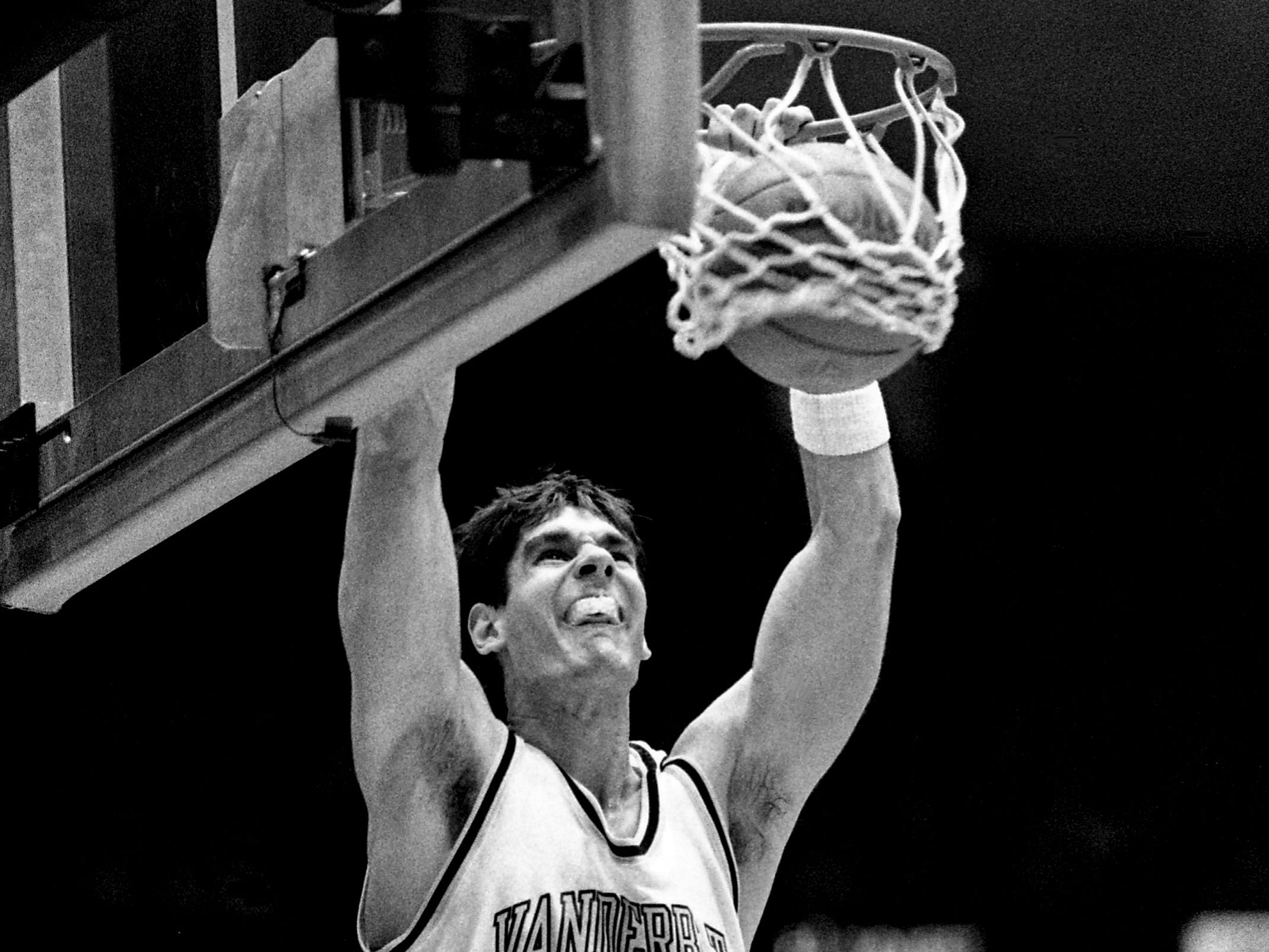 Vanderbilt senior center Frank Kornet dunks with such force he almost lost his mouthpiece. Kornet scored 18 points in the Commodores' 81-51 victory over Kentucky before 15,646 at Memorial Gym on Feb. 8, 1989.