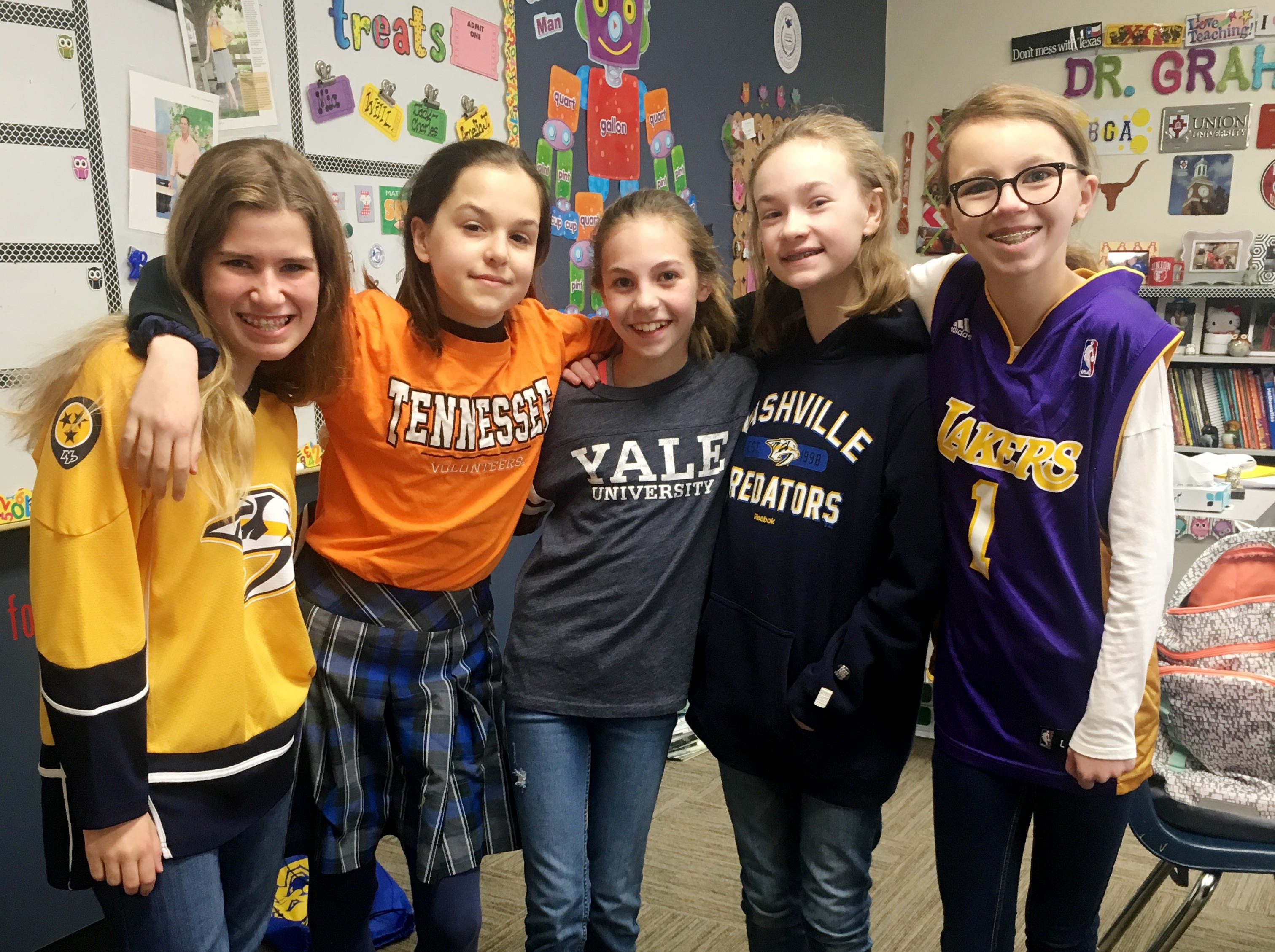 """""""Emma's Dollar Dress Down Days for the DRIVE (the Ms. Cheap Penny Drive, that is!)""""  - COLLECTED: $717.35. Proposed by Emma Kramer, who is in """"Yale"""" shirt for """"Quarters for Quarterbacks"""" day. Left to right...Isabella Besco, Mia Hawkersmith, Emma Kramer, Addison Irvin, and Sophia Grimsley."""