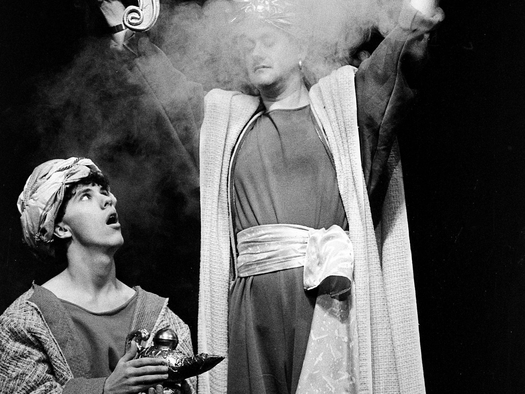 "Phil Perry, right, the Genie of the Lamp, materializes when an astonished Aladdin, played by Corbin Green, rubs the lamp in the Nashville Academy Theater play ""Aladdin"" on Feb. 6, 1989. The play was the first in a new series for preschool through second-grade audiences."