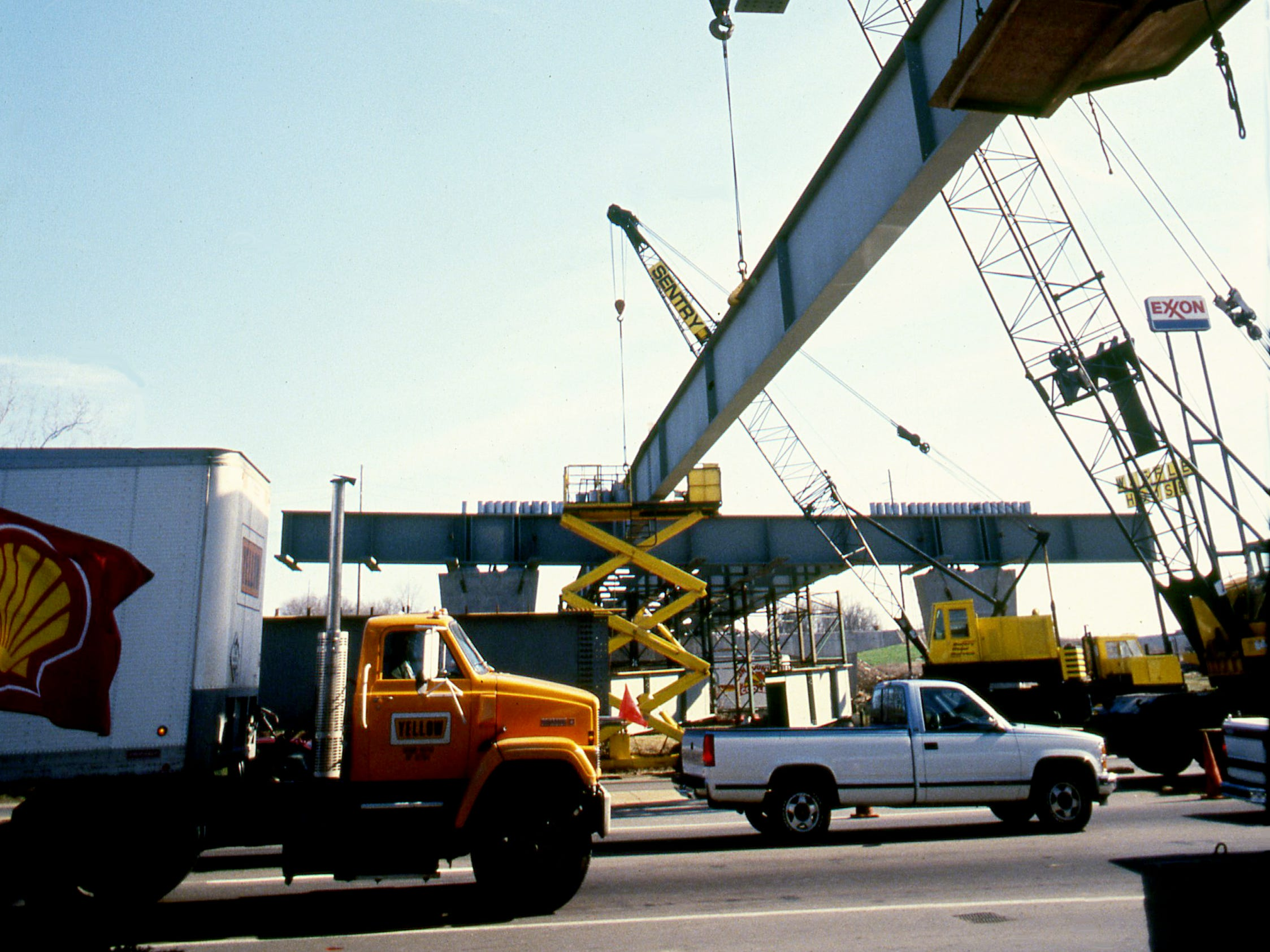 Massive steel beams jut out over Two Mile Parkway on Feb. 7, 1989, as workers connect portions of the planned Hendersonville bypass to Interstate 65.