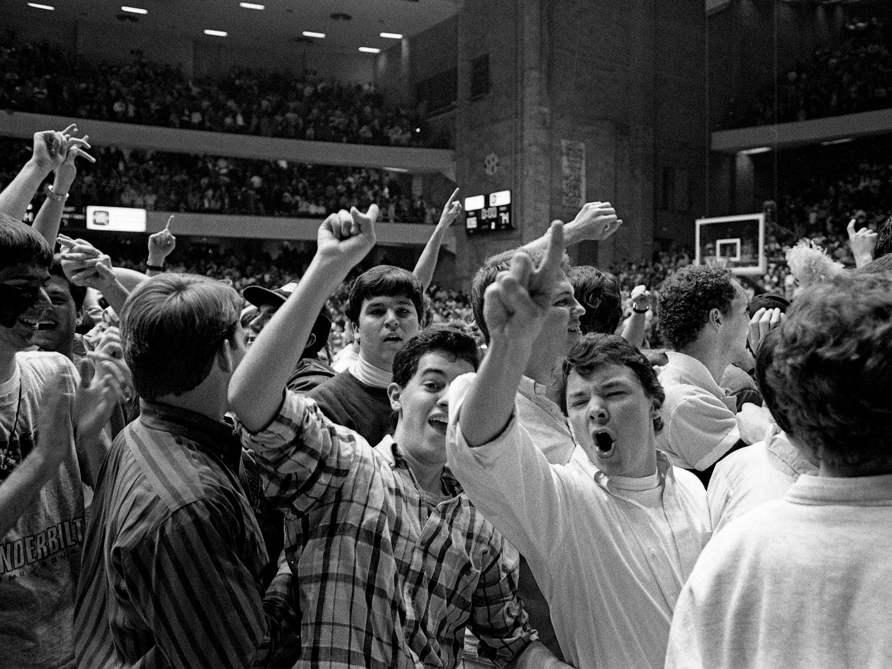 Vanderbilt students and fans celebrate on the Memorial Gym floor Feb. 18, 1989, after the Commodores blew away LSU 108-74 before a deafening partisan crowd of 15,646.