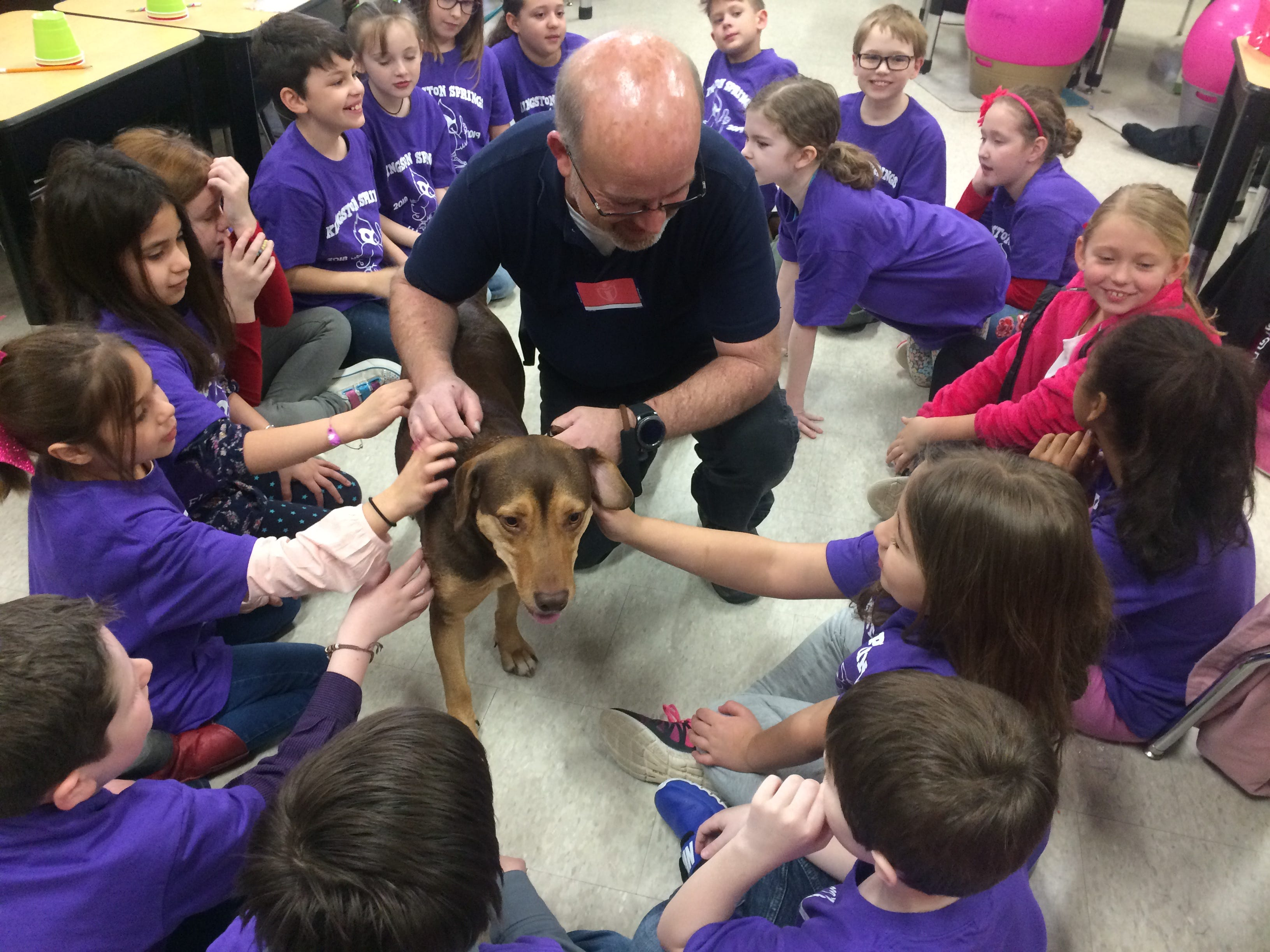 TJ Jordi, former Cheatham County Animal Control director, visits Kingston Springs Elementary School classrooms with 'A Dog's Way Home' star Shelby.