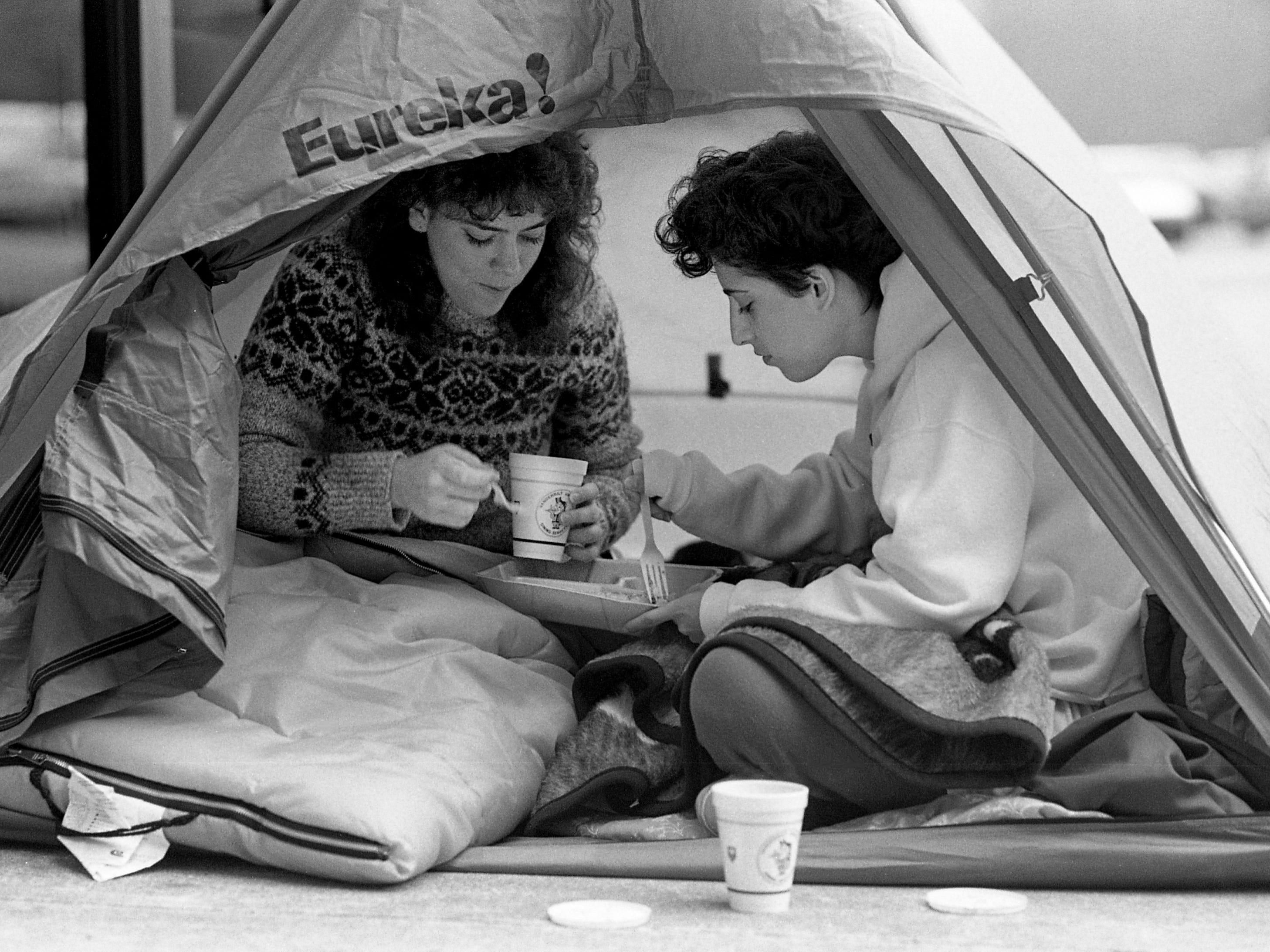 Vanderbilt juniors Pam Peck, left, and Laureen Bastone, the first in line at Memorial Gym on Feb. 4, 1989, eat breakfast while waiting for tickets for the Vanderbilt vs. Kentucky game to go on sale the next day.