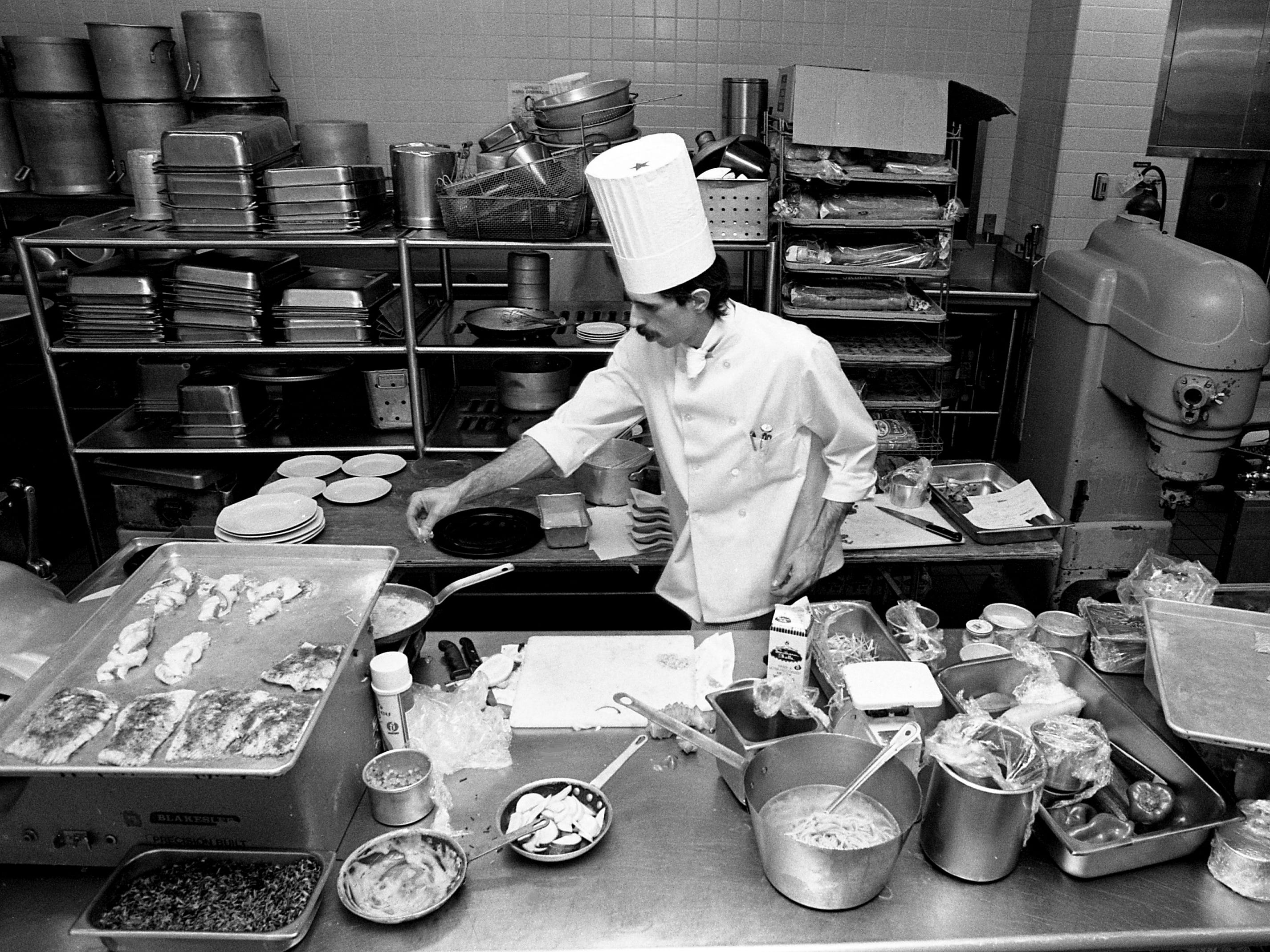Chef Curtis Benson of the Hyatt Regency prepares his entry for the American Seafood Challenge sponsored by Robert Orr/Sysco at Vanderbilt University's Branscomb Hall on Feb. 4, 1989.