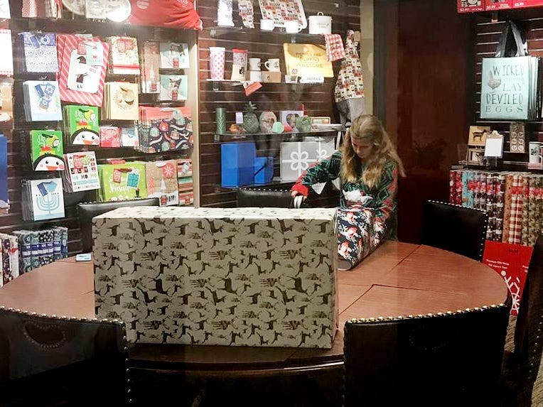 Isabella Besco provided holiday gift wrapping services at HaynesBesco Group in Franklin for donations to the Ms. Cheap Penny Drive. She collected $300!