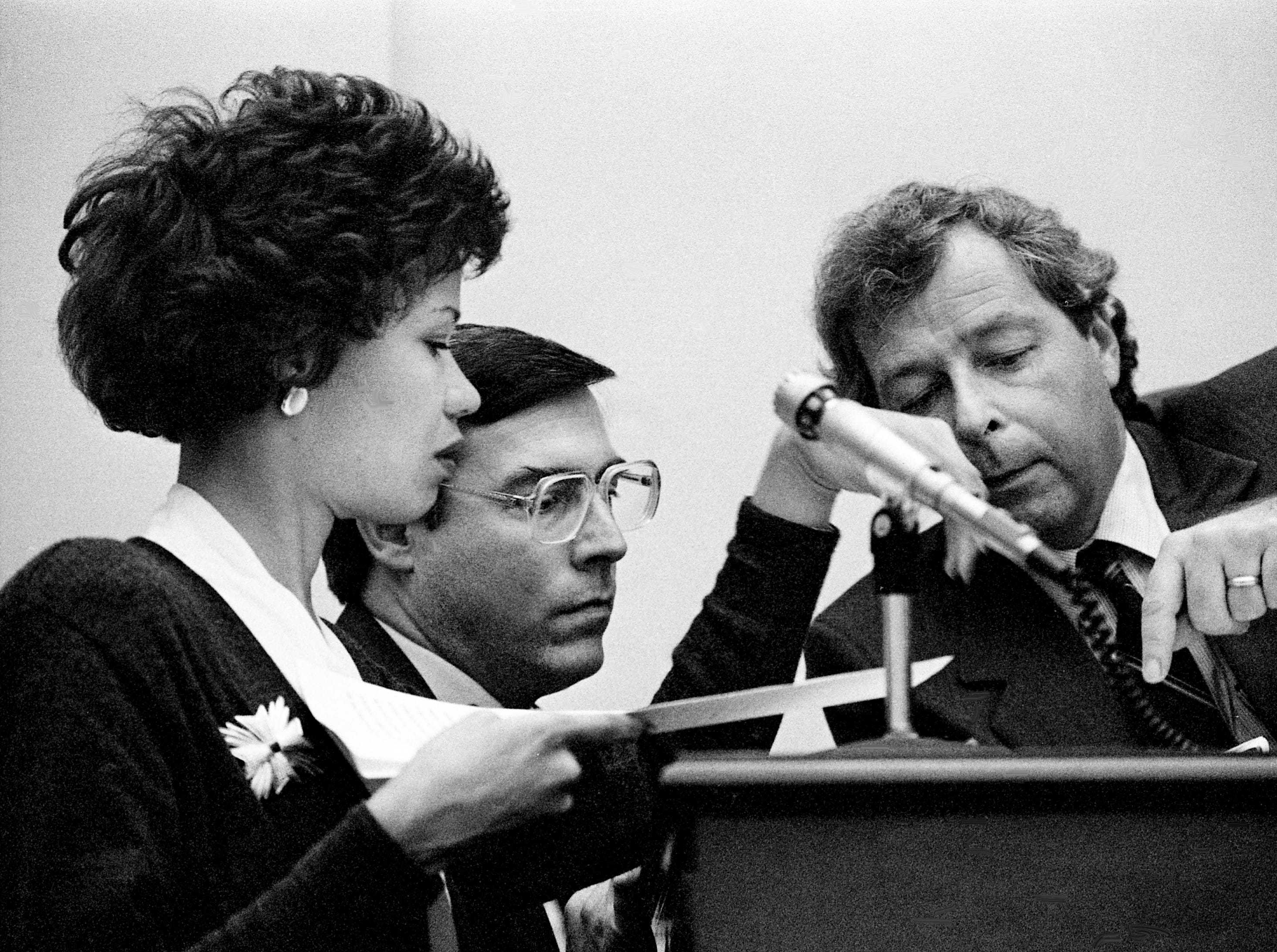 Metro Law Director Susan Short, left, confers with acting Metro Finance Director Gene Noln and Don Jones, attorney and staff director to the Metro Council, about where Mayor Bill Boner can legally order the condemnation of property for landfill testing without the approval of the council during a meeting at the Metro Courthouse on Feb. 7, 1989.