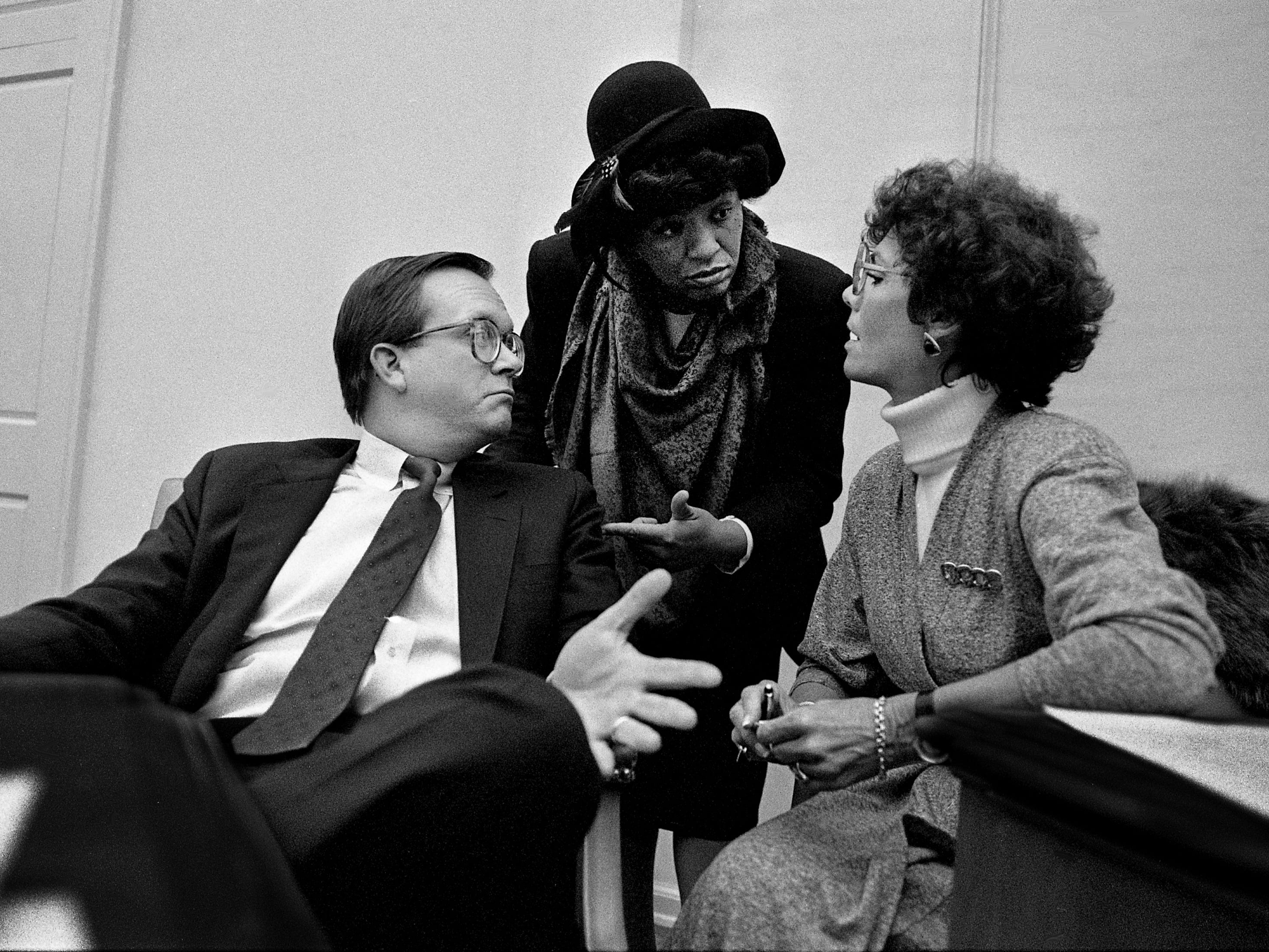 Metro Councilwoman Thelma Harper, center, talks with Councilman Jay West, left, and Councilwoman Jo Ann North about her political battles with Metro Mayor Bill Boner during a council meeting at the Metro Courthouse on Feb. 21, 1989.