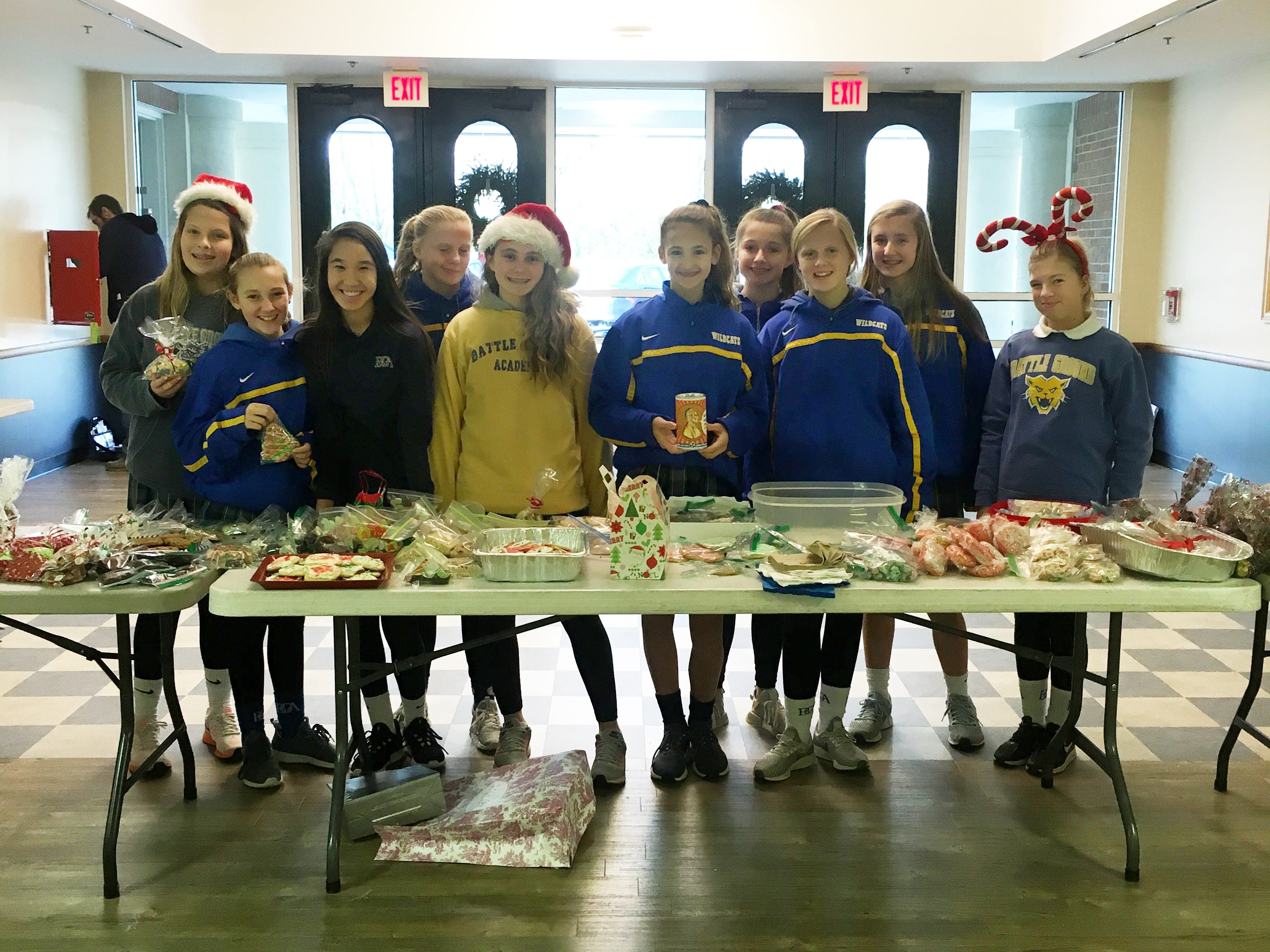 """Christmas Themed Bake Sale - """"Perfectly Sweet""""  They collected: $602.80. From left to right: Sophia Schultenover, Shea Hollis, Maddie Hill, Ella McLay, Evangelene Gallimore, Laurel Phelps, Ava Graddy, Abby McLay, Blythe Dillard, and Lucy Childs."""