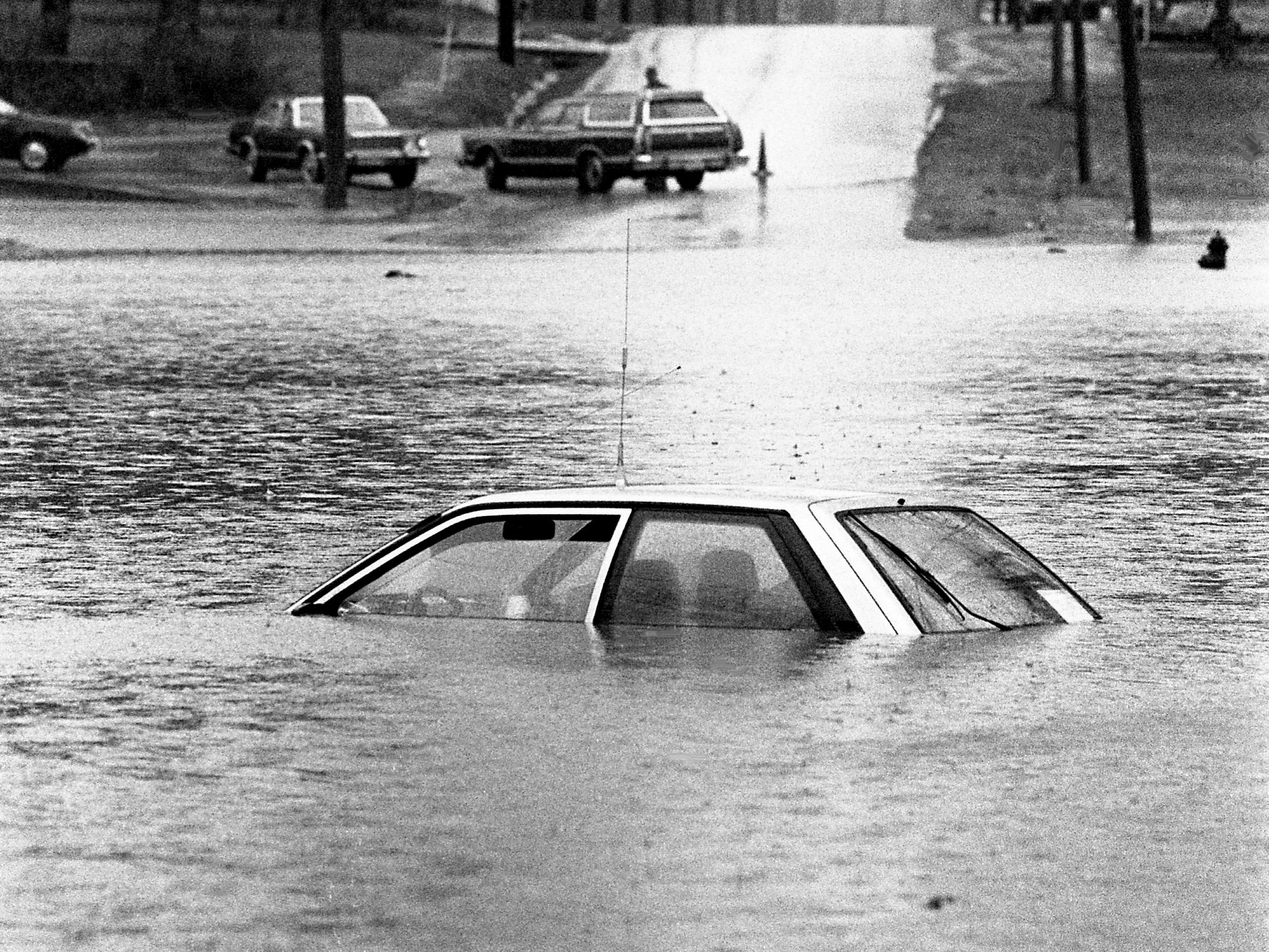 An abandoned car sits submerged in floodwaters near Humana Hospital McFarland in Lebanon on Feb. 14, 1989, after a storm dumped nearly 6 inches of rain on Wilson County.