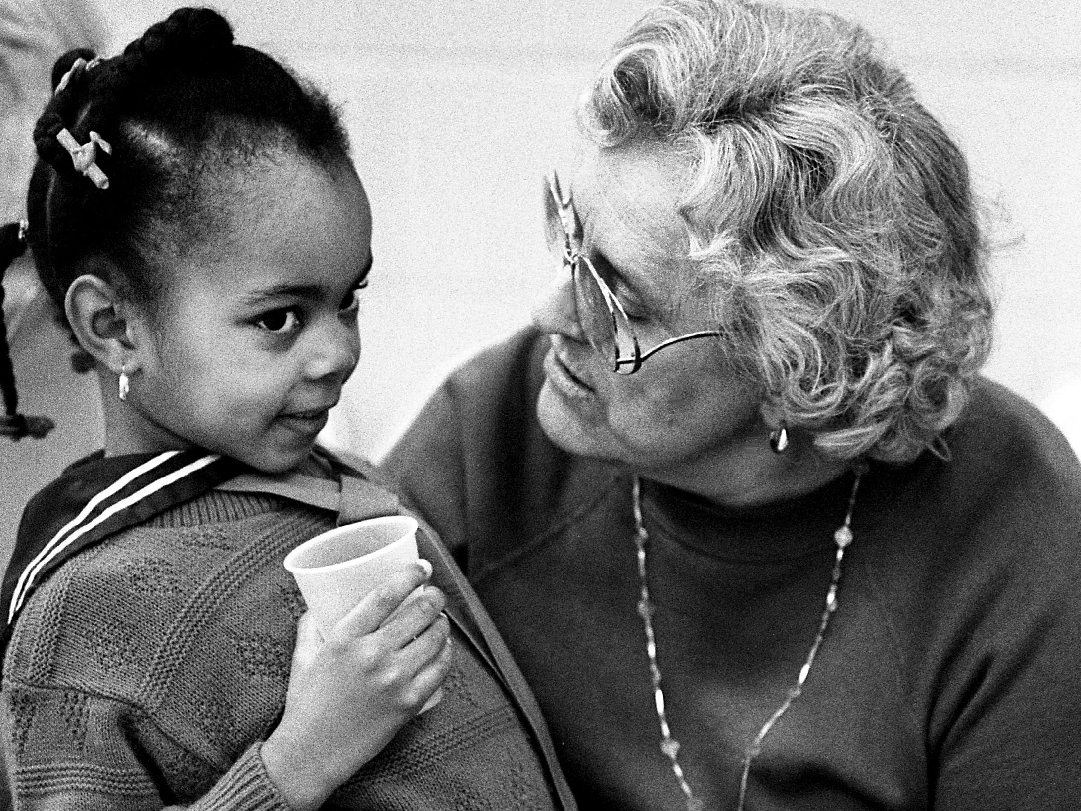 Jennifer Harris, 5, of The Ensworth School, chats with Marie Mills during a Valentine's party at the J.B. Knowles Center on Feb. 13, 1989.
