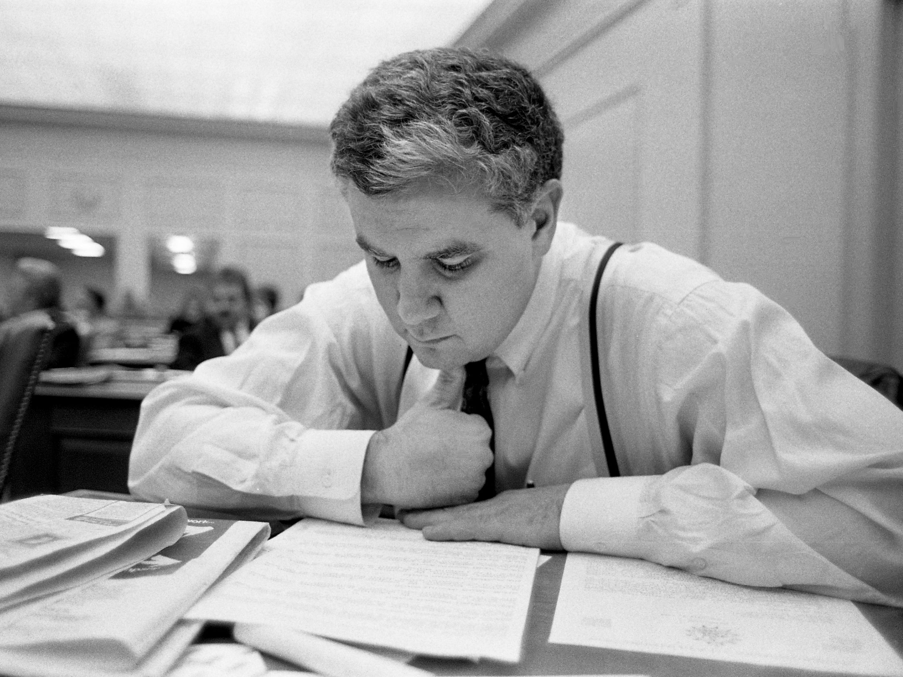 Metro Councilman George Armistead checks his council agenda for upcoming landfill legislation after the council voted 22-15 to test four proposed landfill sites during its meeting at the Metro Courthouse on Feb. 7, 1989.