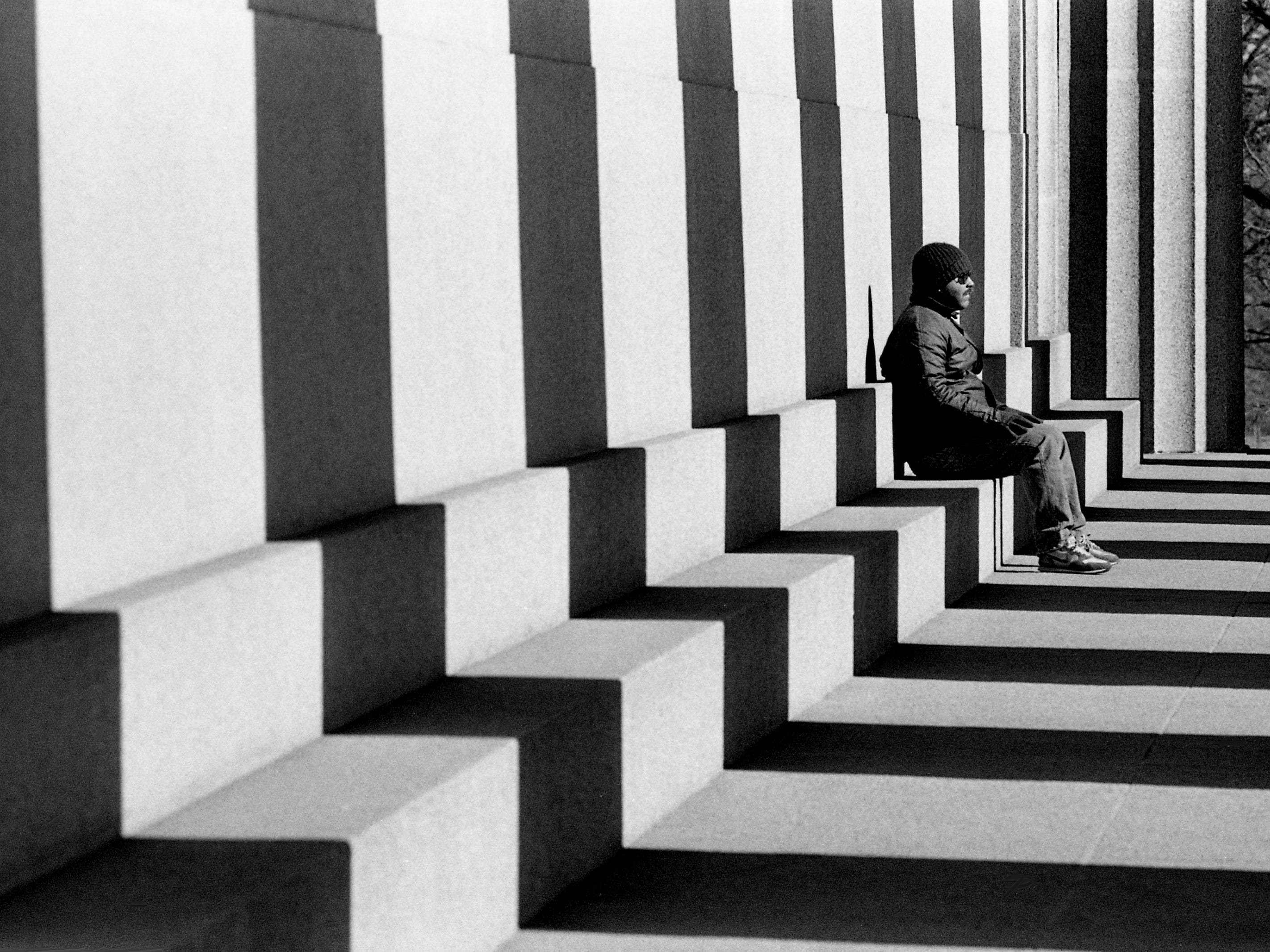 North Nashville resident Howard Robinson Jr. enjoys some winter sunshine while relaxing on the steps of the Parthenon in Centennial Park on Feb. 9, 1989.