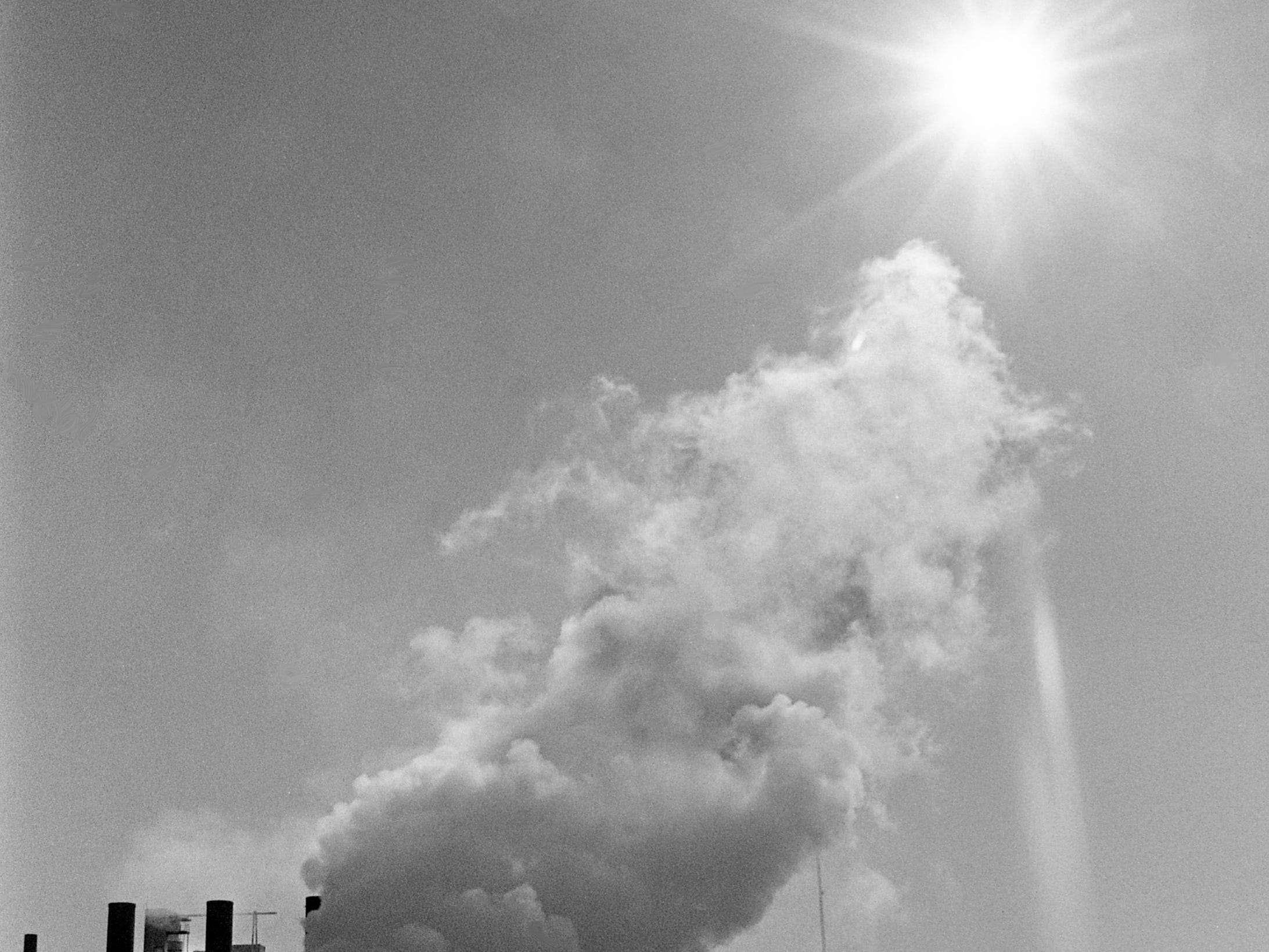 Smoke and steam from the Nashville Thermal Transfer Plant billow through crisp winter air toward the sun Feb. 9, 1989. A hearing is slated March 9 before the Metro Board of Health on a proposal to build a second thermal plant in Cockrill Bend.