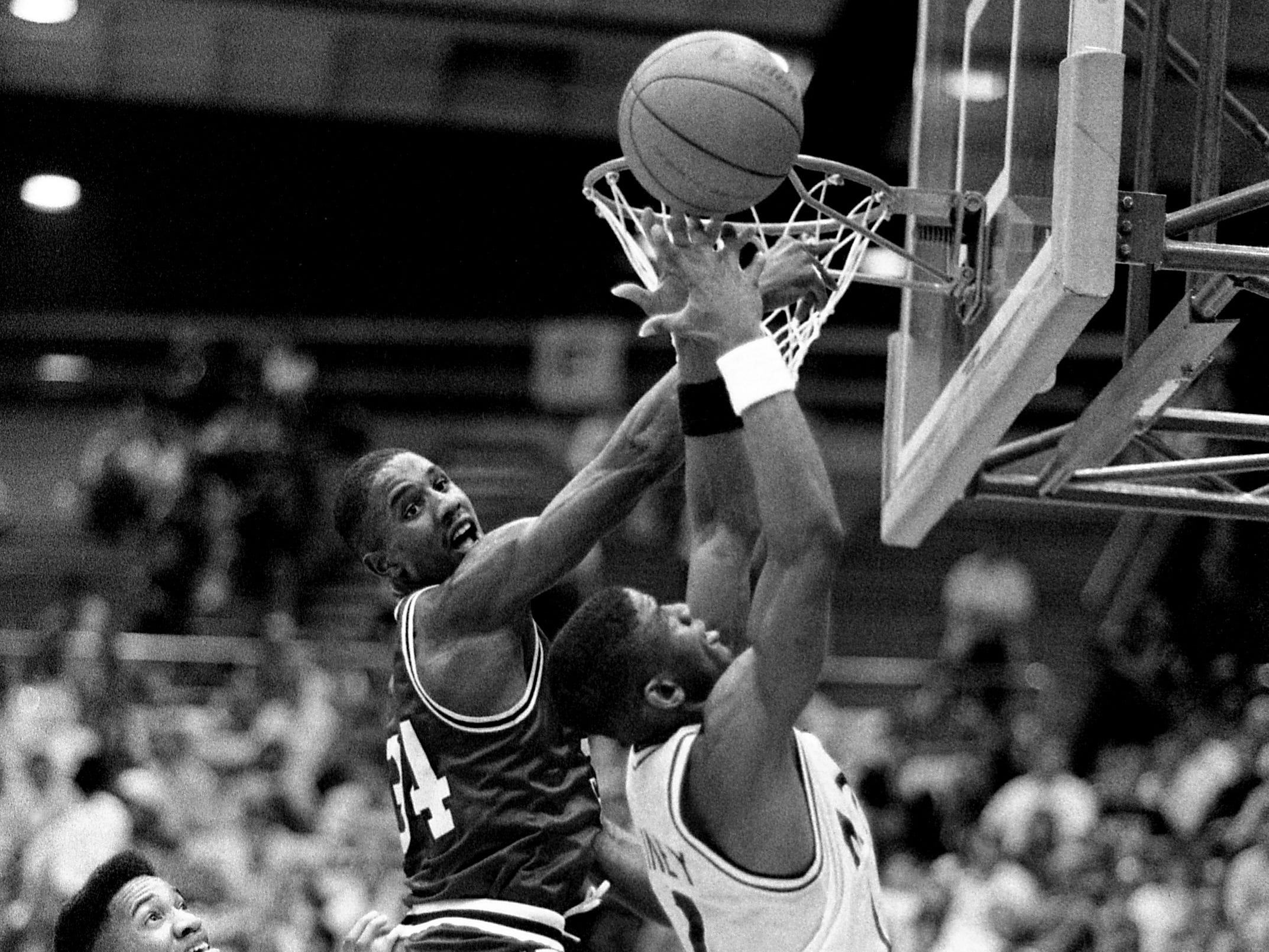 Austin Peay State's LaMonte Ware (34) and Middle Tennessee State's Chris Rainey, right, fight for a rebound in their OVC battle at Murphy Center in Murfreesboro on Feb. 13, 1989. MTSU had to work overtime to pull off a 111-105 victory to stay in first place with an 8-1 record.