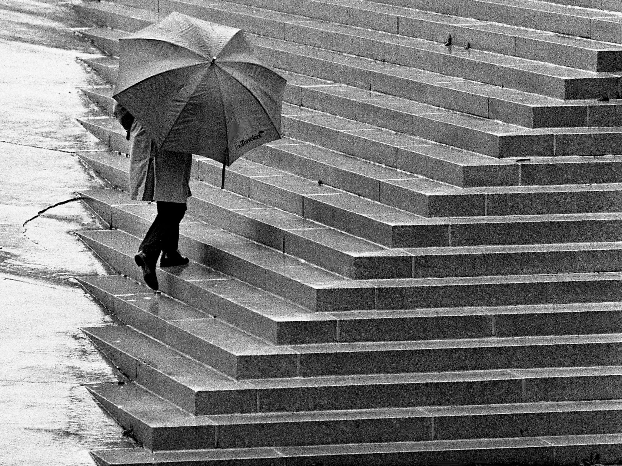 Mark Swaim's umbrella came in handy Feb. 17, 1989, as the state employee walked from the Andrew Jackson Building to the John Sevier Building in downtown Nashville.