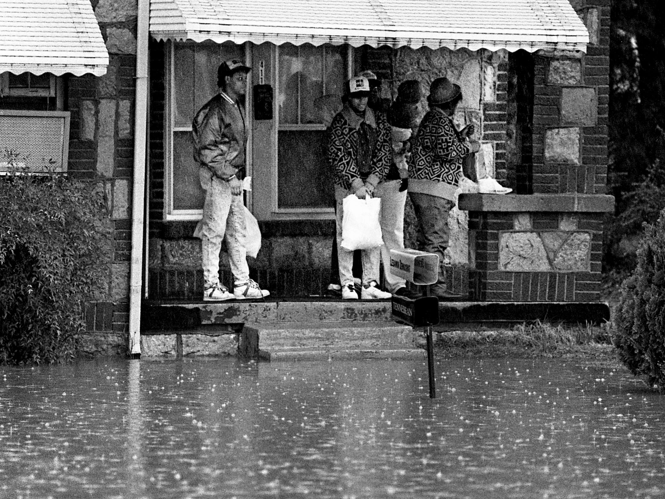 The family of Roy Nunley prepares to evacuate their home on East Spring Street on Feb. 14, 1989, after a storm dumped nearly 6 inches of rain on Wilson County.