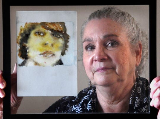 Nakita Click-Putala, a Brentwood woman whose son, Sasha, committed suicide inside the Williamson County Jail while awaiting a court hearing back in 2012 holds a watercolor of her son painted by a family friend Thursday, Feb. 7, 2019, in Franklin, Tenn.