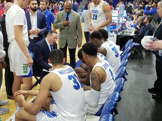 FGCU basketball coach Michael Fly talks to his team during a timeout in a game against NJIT at Alico Arena on Feb. 13.