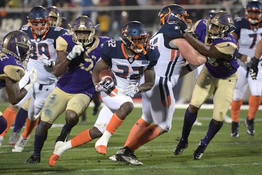 Orlando Apollos running back D'Ernest Johnson (22) rushes for yardage during the first half of an Alliance of American Football game Saturday, Feb. 9 in Orlando. Johnson is a 2014 graduate of Immokalee High School.