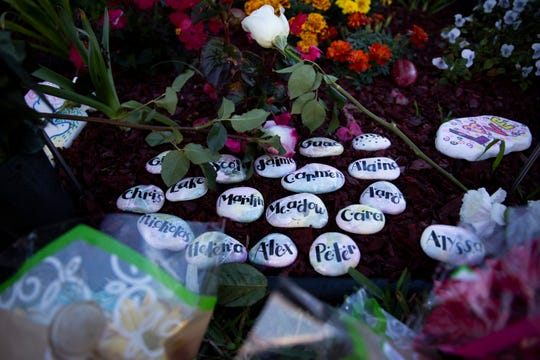 Stones bearing the names of those who were killed lay in the memorial garden during the commemoration of the mass shooting that claimed 17 lives at Marjory Stoneman Douglas High School in Parkland, Florida, on Thursday, February 14, 2019.
