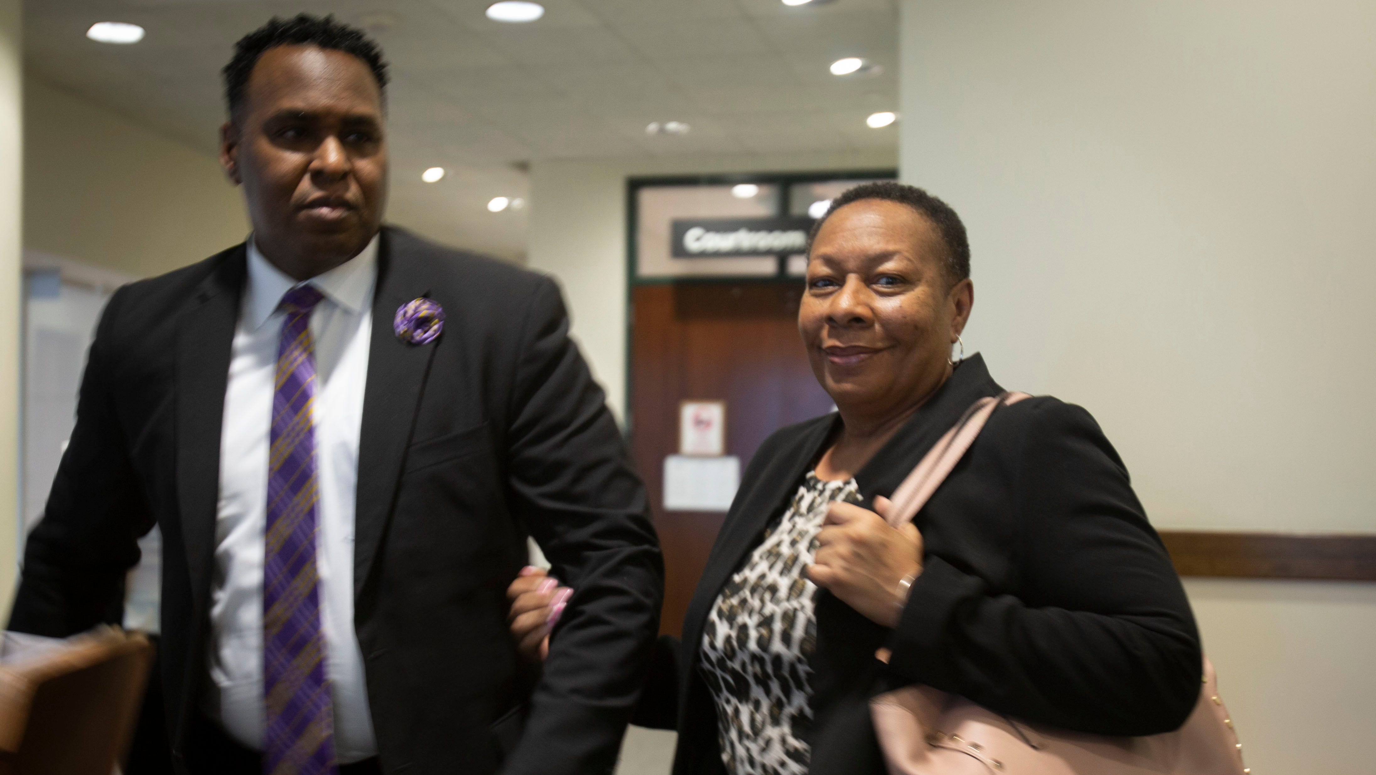 Attorney Christopher O'Neal and mother of Terrance Williams, Marcia stand outside courtroom 3-1 at the Collier County Courthouse Thursday, Feb.14, 208. O'Neal is one of the attorneys representing Williams' estate in a lawsuit filed against former CCSO deputy Steven Calkins that states he is responsible for the disappearance and death of two Collier men.