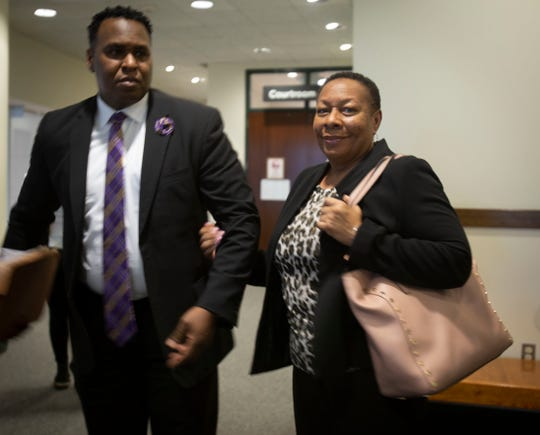 Attorney Christopher O'Neal and Terrance Williams' mother, Marcia, stand outside a courtroom at the Collier County Courthouse on Thursday, Feb.14, 2019. O'Neal is one of the attorneys representing Williams' estate in a wrongful-death lawsuit filed against former Collier County sheriff's deputy Steven Calkins. The lawsuit accuses Calkins of being responsible for Terrance Williams' disappearance and death.
