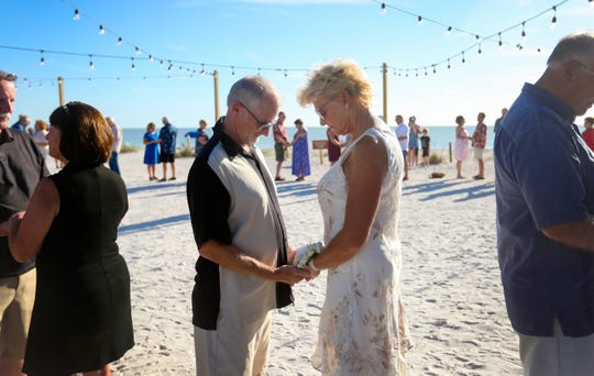 Jack and Pam Selix share a moment of silence as they renew wedding vows on Valentine's Day at Lovers Key State Park.
