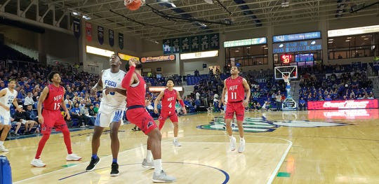 FGCU sophomore Bryan Thomas positions himself for a rebound against NJIT in a game at Alico Arena on Wednesday, Feb. 13, 2019.