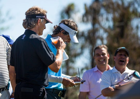 Bernhard Langer talks with his pro-am teammates on the second day of the Chubb Classic at The Classics Country Club in Lely Resort on Thursday.