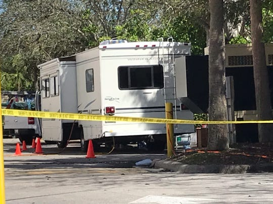 Deputies from the Collier County Sheriff's Office investigating a death taped off an area in the parking lot and roadway behind Carillon Place in North Naples on Feb. 14, 2019.