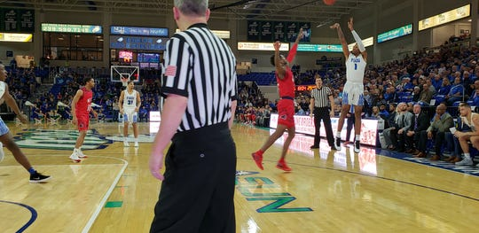 FGCU sophomore Troy Baxter, Jr. (right) attempts a 3-pointer against NJIT in a game at Alico Arena on Wednesday, Feb. 13, 2019.