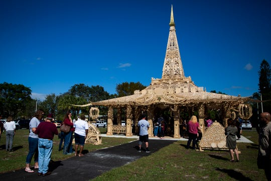 Community members come to pay their respects during the commemoration of the mass shooting that claimed 17 lives at Marjory Stoneman Douglas High School at the Temple of Time, constructed by David Best and a crew of volunteers in Coral Springs, Florida, on Thursday, February 14, 2019.