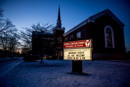 A sign advertises the temporary  warming shelter available for the homeless in January at Central Christian Church on Mt. Vernon Ave. The Church opened it doors to the homeless for two nights at the end of January as temperatures dropped below zero.