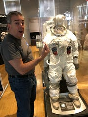 David DeFelice, Community Relations Outreach director for NASA's Glenn Research Center, explains the backup suit of Apollo 8 astronaut Bill Anders on display at The Work's Apollo exhibit.