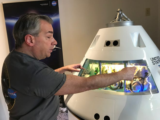 David DeFelice, Community Relations Outreach director for NASA's Glenn Research Center, talks about how three astronauts were wedged into Apollo capsules during space missions. The Apollo exhibit opened Saturday at The Works.