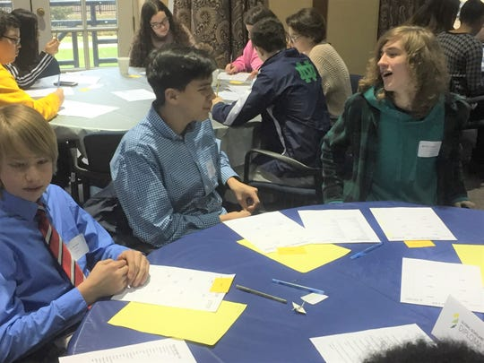 "GHS student Julian Rodgers (center, blue-checkered shirt) teams with others for a ""refugee experience"" at Franklin University Feb. 12."