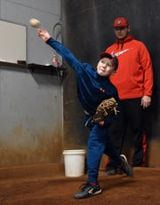Mason Bennett, 10, works on his fastball with pitching instructor Andrew Ford at Fearless In The Zone in Newark. Bennett, a student at Stevenson Elementary School in Heath, was born with congenital heart defects and has been through six heart surgeries, but remains active, is on all-star baseball teams and also plays other sports.