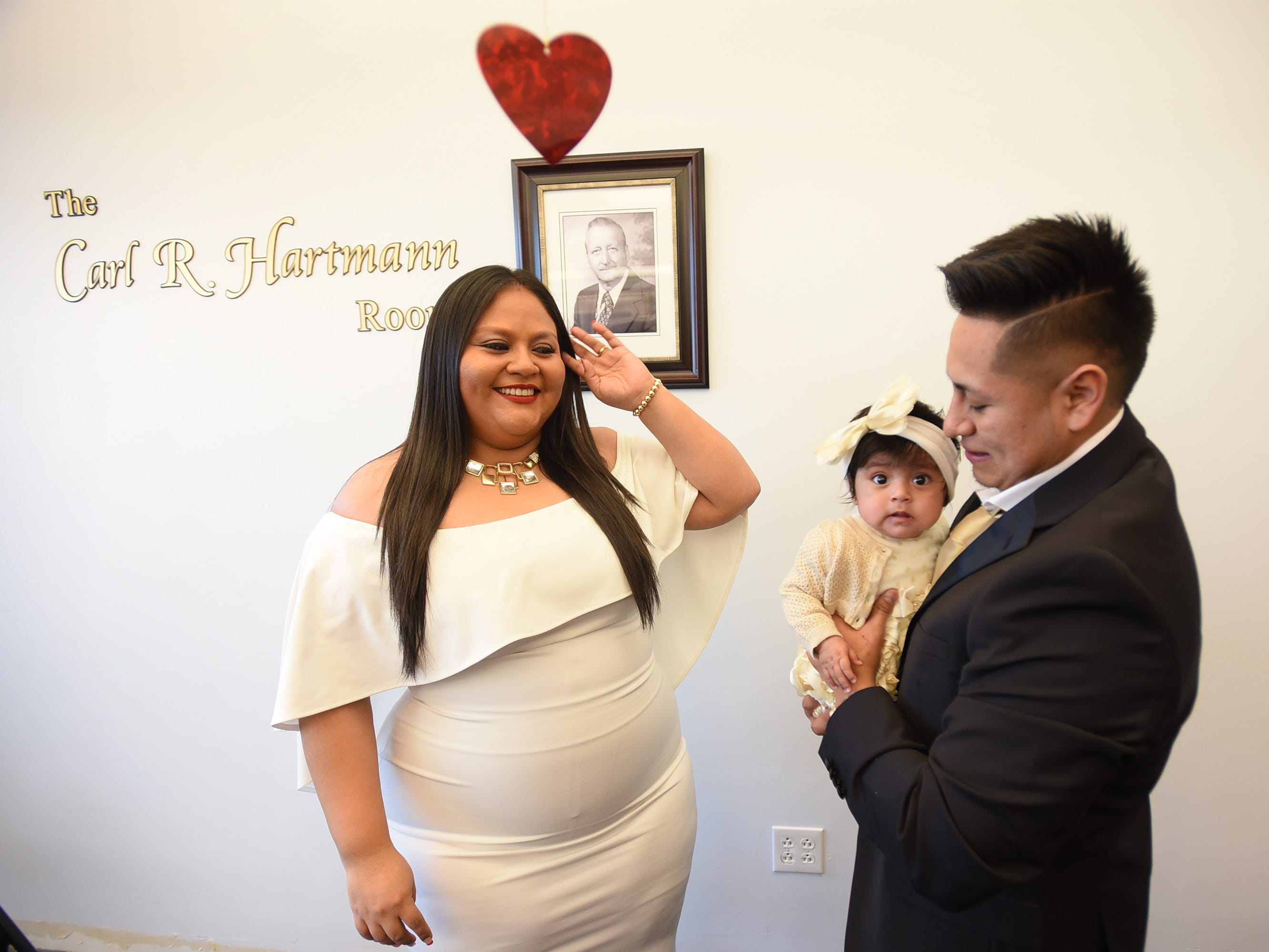 After being announced as a husband and a wife, Yesenia Urgiles and Cesar Guartan of Hackensack, prepare to have photos taken together with their five month daughter Lilian following their wedding ceremony, located at Bergen County Plaza in Hackensack on 02/14/19.