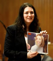 Closing arguments are delivered in the trial of Arthur Lomando at the Bergen County Courthouse in Hackensack on Thursday, February 14, 2019. Lomando, a former New York City police officer, is accused of murdering Suzanne Bardzell, his ex-girlfriend, with a machete. Bergen County Asst. Prosecutor Kristen DeMarco shows a picture of Suzanne Bardzell, the deceased ex-girlfriend of Lomando, to the jury while delivering her closing arguments for the prosecution.