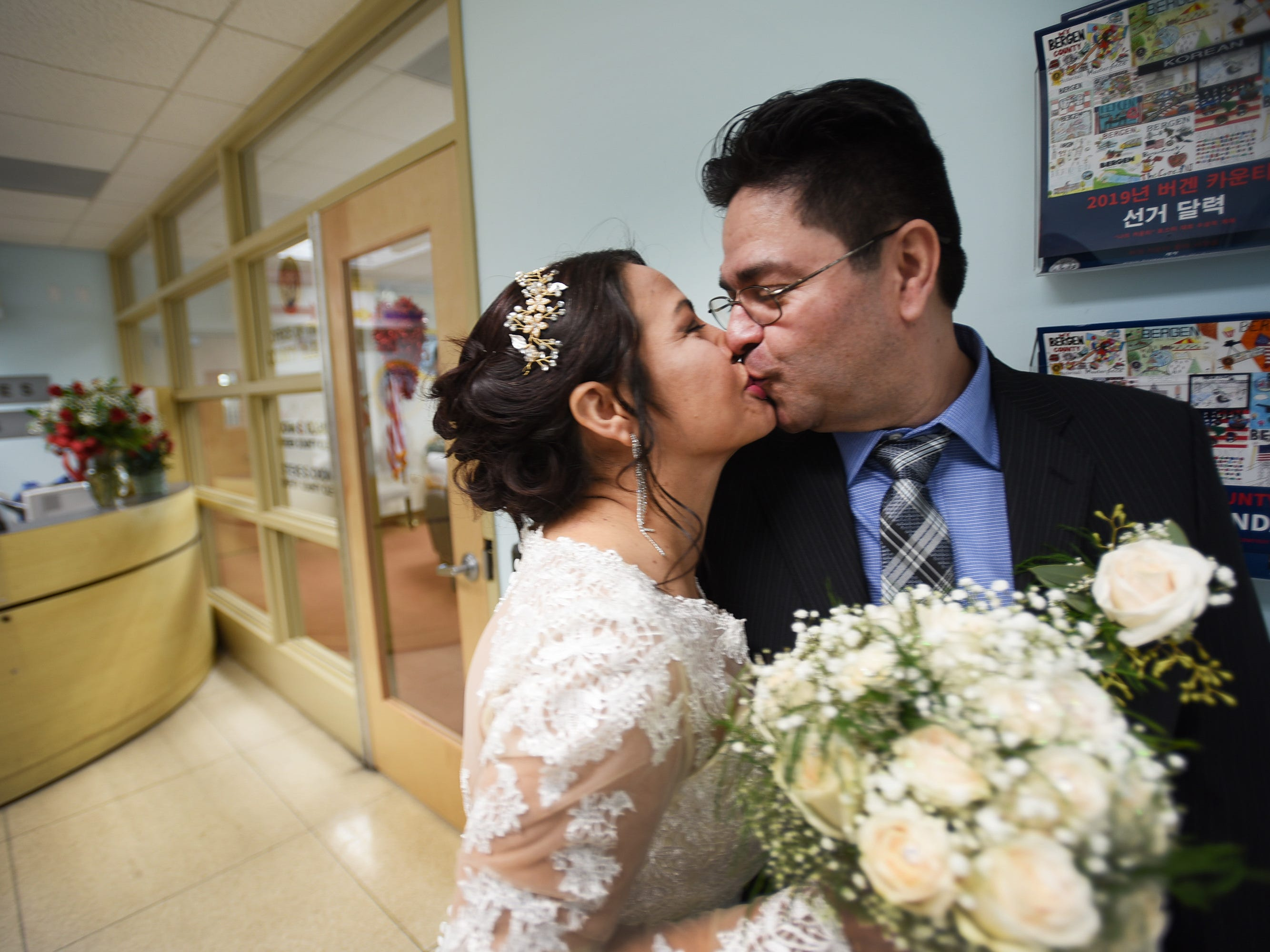 After their marriage ceremony, Gloria Gallego and Alexander Gutierrez of Englewood, kiss together on the hallway outside of Bergen County Clerk's Office, located at Bergen County Plaza in Hackensack on 02/14/19.