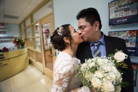 After their marriage ceremony, Gloria Gallego and Alexander Gutierrez of Englewood, kissed in the hallway outside the Bergen County Clerk's Office, in Hackensack Valentine's Day, 2019.