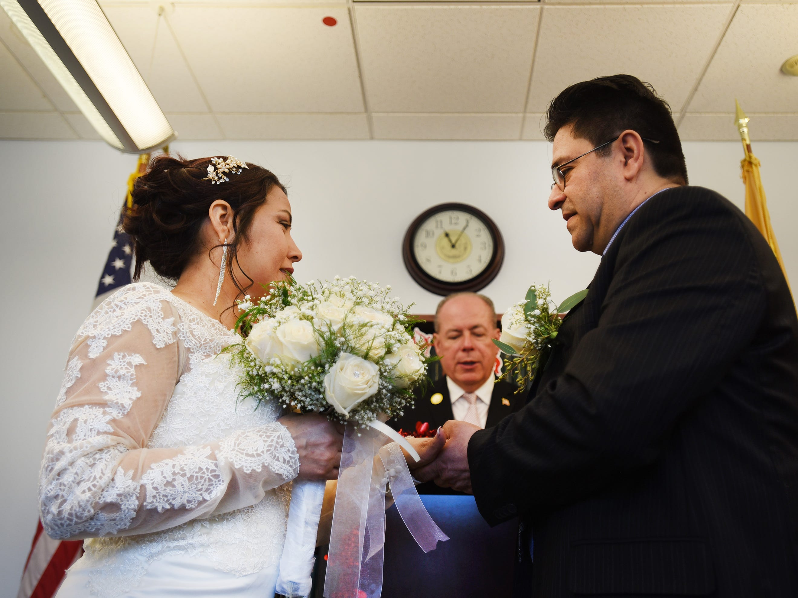 Bride and groom, Gloria Gallego and Alexander Gutierrez of Englewood, exchange their wedding rings before Bergen County Clerk John S. Hogan during their wedding ceremony, located at Bergen County Plaza in Hackensack on 02/14/19.