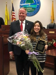 Bloomingdale Mayor Jon Dunleavy stands with Jennifer Crawford Ellis, the town's 2018 Volunteer of the Year, during the Jan. 7, 2019 town council meeting.