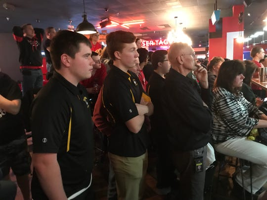 West Milford bowlers Shane Yodice (left) and RJ Utter (center), along with coach John Caillie, watch intently as Woodbridge finishes its third game at the NJSIAA boys bowling team finals on Thursday, Feb. 14, 2019 at Bowlero North Brunswick. Woodbridge overtook the Highlanders for the Group 3 title in the final frames.