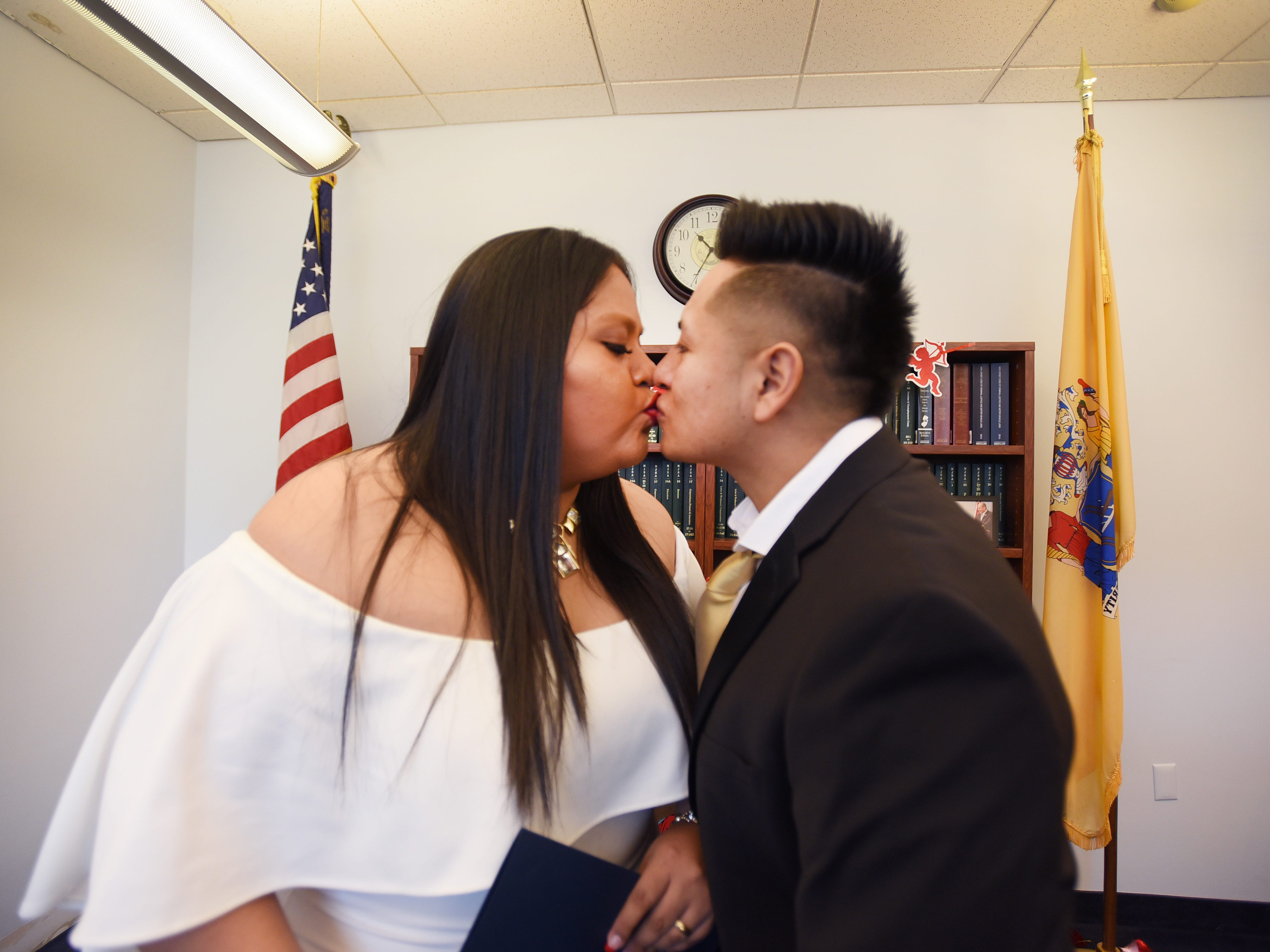 Yesenia Urgiles and Cesar Guartan of Hackensack, kiss together right after being announced as a husband and a wife by Bergen County Clerk John S. Hogan during their wedding ceremony, located at Bergen County Plaza in Hackensack on 02/14/19.