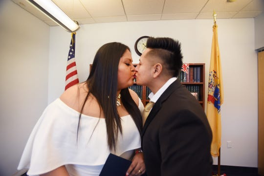 Yesenia Urgiles and Cesar Guartan of Hackensack, kissed outside the Bergen County Clerk's Office, in Hackensack Valentine's Day, 2019 soon after they became husband and wife.