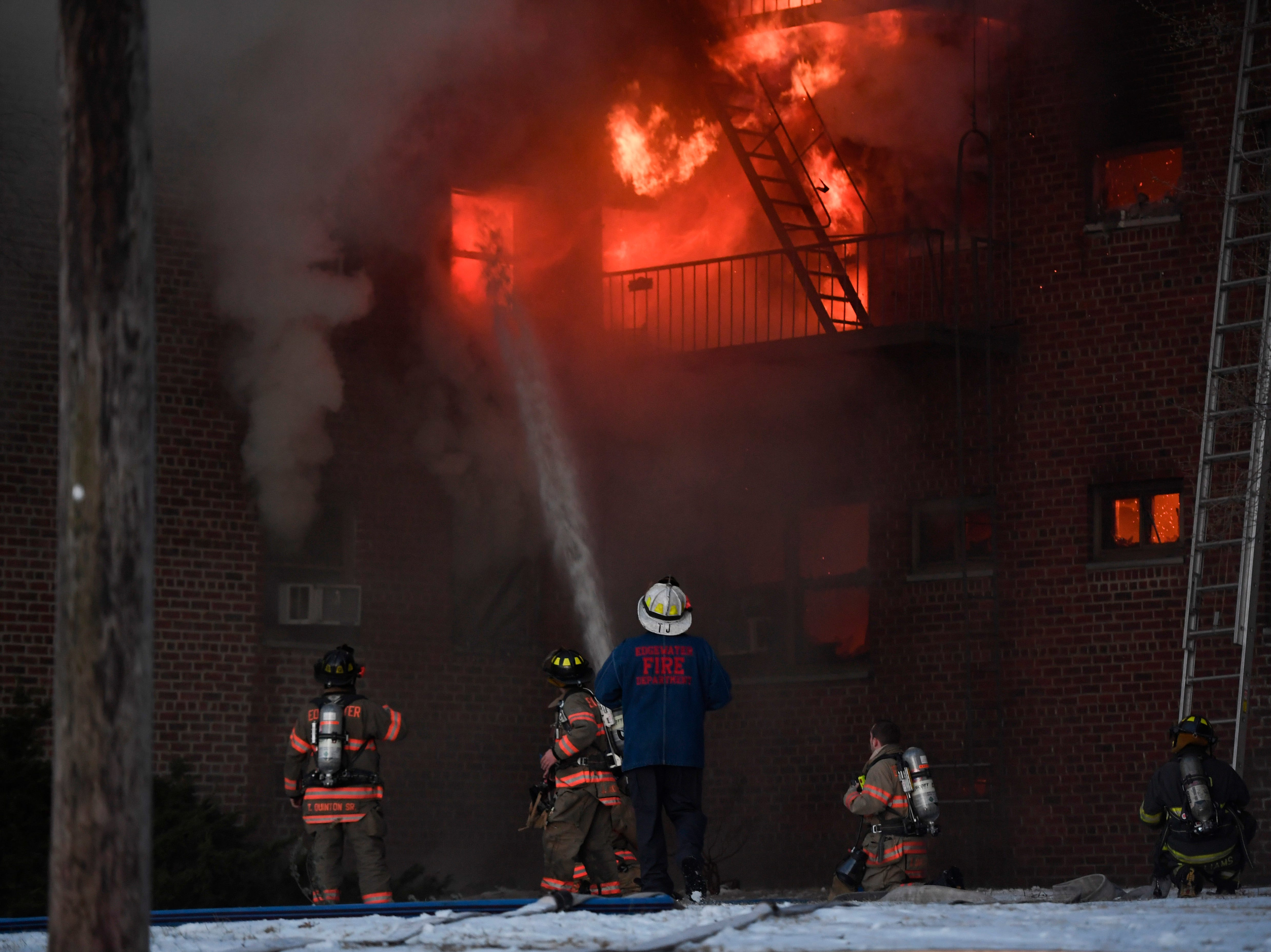 Edgewater firefighters work on a fire in an apartment building on Edwin avenue in Fort Lee on Thursday, Feb. 14, 2019.