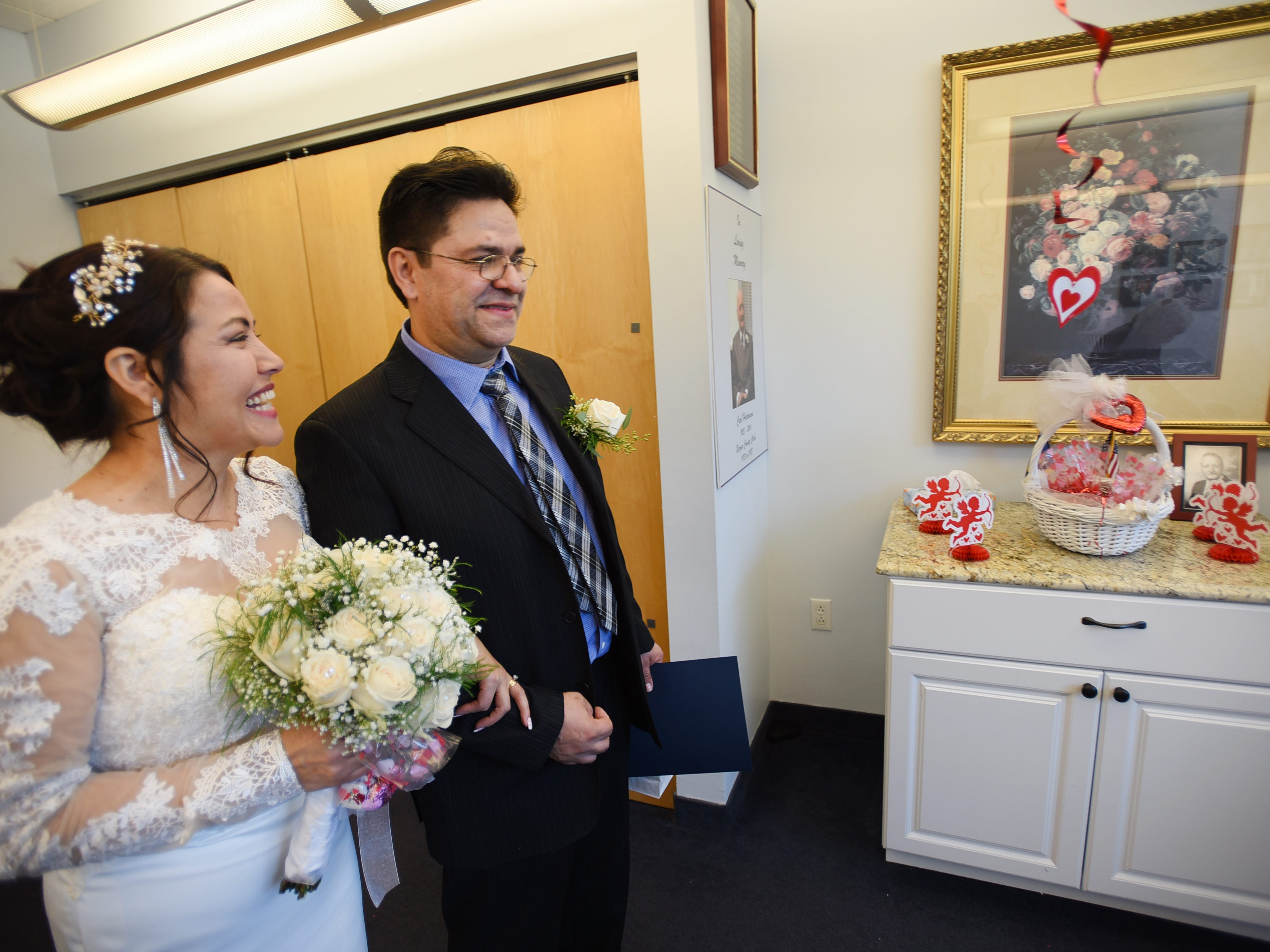 After being announced as a husband and a wife, Gloria Gallego and Alexander Gutierrez of Englewood, smile following their wedding ceremony, located at Bergen County Plaza in Hackensack on 02/14/19.