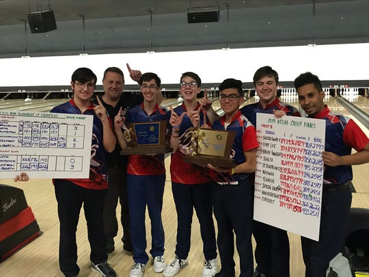 Jackson Liberty celebrates winning the Tournament of Champions at the NJSIAA boys bowling team finals on Thursday, Feb. 14, 2019 at Bowlero North Brunswick.